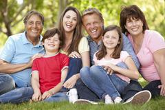 Multi generation Hispanic family in park - stock photo