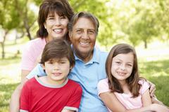 Hispanic grandparents and grandchildren outdoors - stock photo