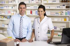Stock Photo of UK nurse and pharmacist working in pharmacy