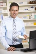 Stock Photo of UK pharmacist at work