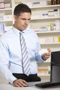 Stock Photo of UK pharmacist working on computer