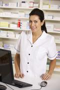 American pharmacist using computer in pharmacy - stock photo