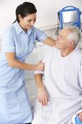 Nurse helping male patient in UK Accident and Emergency Stock Photos