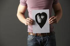 Man holding ink drawing of heart Stock Photos