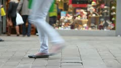 People walk busy street - legs only - low angle Stock Footage