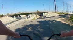 Riding Bicycle Under Traffic Bridges- San Gabriel River Trail Stock Footage