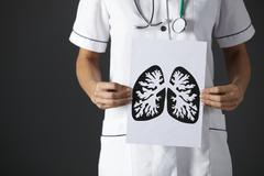 American nurse holding ink drawing lungs Stock Photos