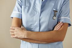 Stock Photo of UK nurse standing with arms folded