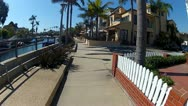 Riding Bicycle Along Canals Of Naples Island District, Long Beach CA Stock Footage