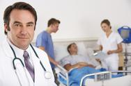 Stock Photo of American doctor and team on hospital ward