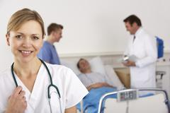 American doctor and team on hospital ward - stock photo