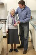 Mother and adult son in kitchen Stock Photos