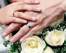 Closeup Of Newlywed Couple Holding Hands Stock Photos