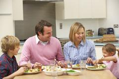 Family sharing meal together at home Stock Photos