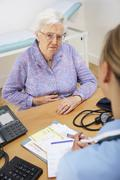 Senior woman patient with UK nurse Stock Photos
