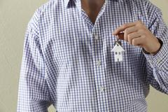 Cropped Shot Of Man Holding Keys To First Home - stock photo