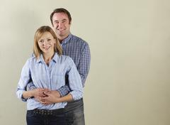 Studio Shot Of Relaxed Middle Aged Couple Stock Photos