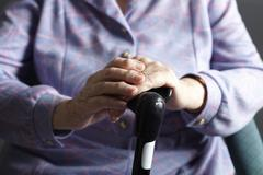 Close Up Of Senior Woman Holding Walking Stick - stock photo