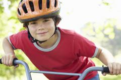 Boy riding bike - stock photo