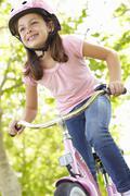 Girl riding bike - stock photo