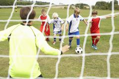Player ready to score goal in Junior 5 a side Stock Photos