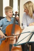 Boy playing cello in music lesson Kuvituskuvat