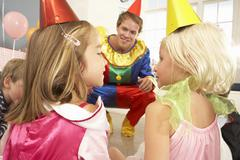 Clown entertaining children at party - stock photo