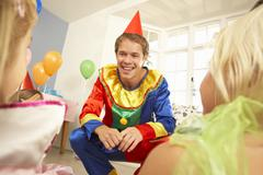 Clown entertaining children at party Stock Photos