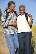 Senior   couple on country hike Stock Photos