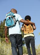 Father and son on country hike Stock Photos