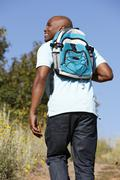 Young  man on country hike Stock Photos