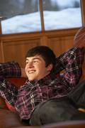 Teenage Boy Relaxing On Sofa - stock photo