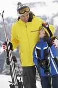 Father And Son On Ski Holiday In Mountains Stock Photos