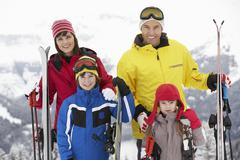 Family On Ski Holiday In Mountains Stock Photos