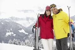 Middle Aged Couple On Ski Holiday In Mountains - stock photo
