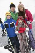 Group Of Children On Ski Holiday In Mountains - stock photo