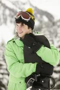 Teenage Boy With Snowboard On Ski Holiday In Mountains Stock Photos