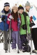 Stock Photo of Family On Ski Holiday In Mountains