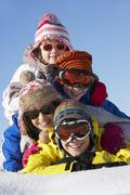 Group Of Children Having Fun On Ski Holiday In Mountains - stock photo