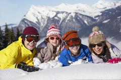 Group Of Children Having Fun On Ski Holiday In Mountains Stock Photos