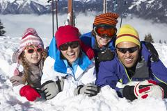 Family Having Fun On Ski Holiday In Mountains Stock Photos