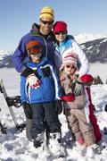 Family On Ski Holiday In Mountains Stock Photos