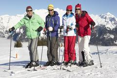 Group Of Middle Aged Couples On Ski Holiday In Mountains Stock Photos