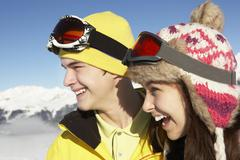 Stock Photo of Two Teenagers On Ski Holiday In Mountains