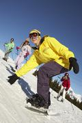 Teenage Family On Ski Holiday In Mountains Stock Photos
