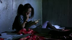 Young untidy woman reading book. Stock Footage
