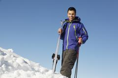 Middle Aged Man On Ski Holiday In Mountains Stock Photos