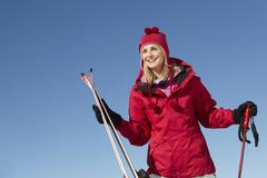 Stock Photo of Middle Aged Woman On Ski Holiday In Mountains