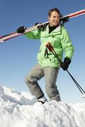 Middle Aged Man On Ski Holiday In Mountains - stock photo