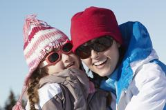 Mother And Daughter Having Fun On Ski Holiday In Mountains Stock Photos